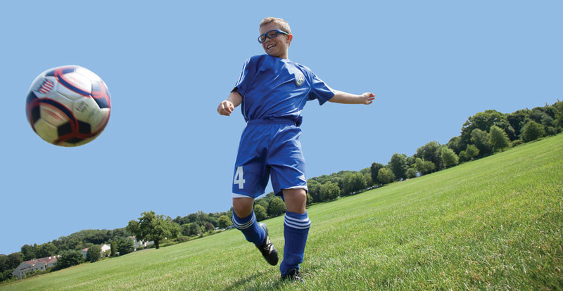 Wiley X Youth Force Sports Glasses - Boy Kicking a Soccer Ball