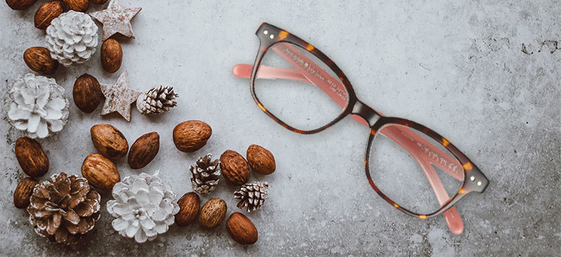 Kate Spade glasses with Christmas background