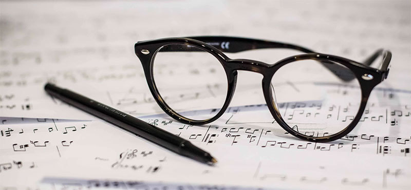 Glasses on top of sheet music